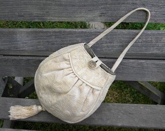 One of a kind hand made purse with antique button closure
