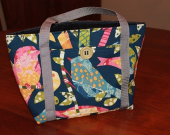 Insulated lunch bag.  Perching bird durable fabric.