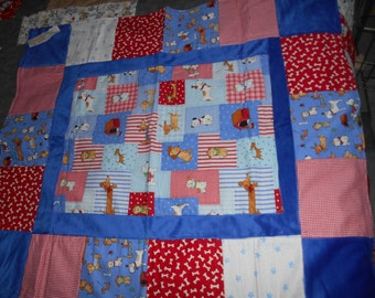 Baby quilt with red and blue dogs