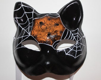 Cat mask with spiders and webs with diamonds