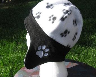 Reversible Black and White Paw Print Fleece Ear Flap Hat