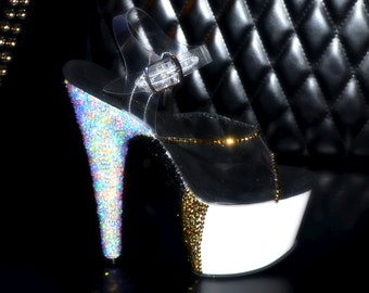 Hand strassed exotic /pole dance heels. One of a kind designs that are a must for the dance diva!