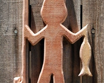 Wooden Cut Out Of A Fisherman