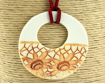 Rust and white porcelain lace patterned pendant