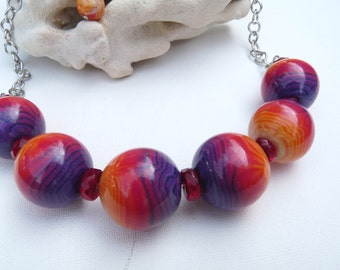 Necklace large beads on memory wire rainbow gradient polymer