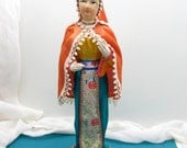 Beautiful vintage soft-sculpture fabric doll on stand