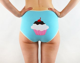 Blue panties with large cup cake on the back