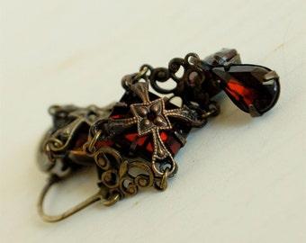 gothic medieval earrings, ornate aged brass, garnet red jewelry, rhinestone dangle earrings, filigree rhinestone jewelry