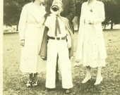 Tooting His Horn Little Boy Blowing into Trumpet Wearing Hat Cape Band Uniform 1930s Vintage Black White Photo Photograph