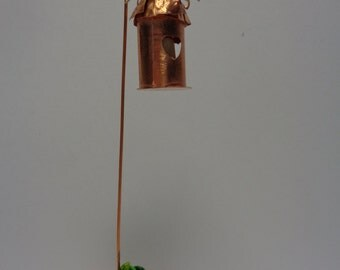 Mini copper lantern with glow in the dark candle in terra cotta pot with polymer clay plants