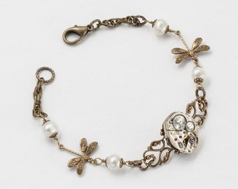 Steampunk Bracelet Vintage silver watch movement gears with gold filigree dragonfly charms pearls rope chain bracelet Steampunk Jewelry