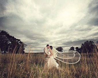 Cathedral lace veil in two tier with blusher and gathered top on a metal comb with Alencon lace edge design, beaded wedding veil