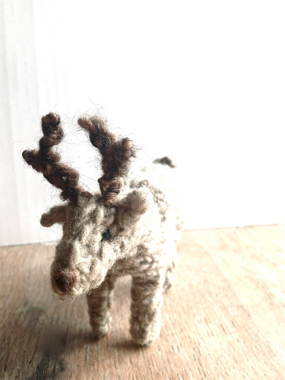 Knitting Pattern For Reindeer Antlers : Little knitted reindeer with antlers
