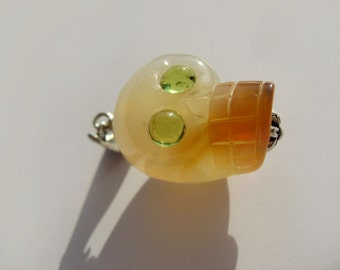 Natural Agate Carved Scull With Peridot Eyes In Sterling Silver Pendant