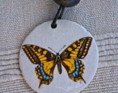 Butterfly pendant, 2-sided pendant: yellow, black and blue butterfly and dusty pink flower.