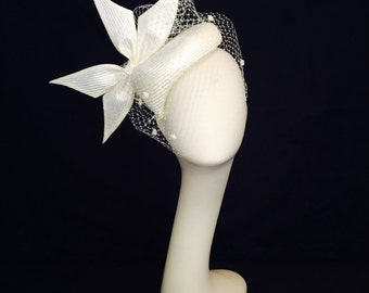 Ivory parasisal bridal fascinator with custom bow and vintage inspired polka dots veil