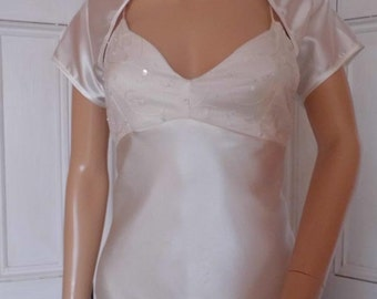 Ivory  satin cap sleeved bolero/shrug/jacket  with satin edging