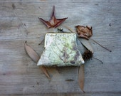 Forest floor woodland leaves clutch purse grey earthy brown green nature fall autumn calm gentle silver veins skeleton botanical camouflage