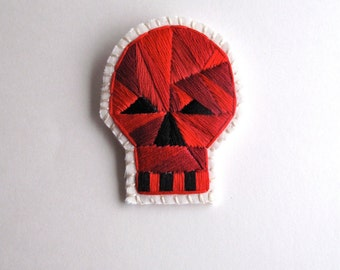 Halloween skull brooch with red geometric design hand embroidered on cream muslin and cream felt Day of the Dead E1