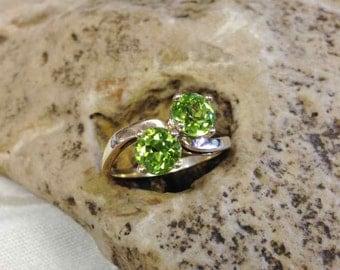 Peridot By-Pass Ring Set in !4 Karat Yellow Gold Mounting