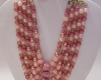 Five Strand Pink Bead Necklace and Clip Earrings Signed Haru Demi Parure