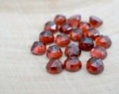 5mm red garnet cabochon - rose faceted. 2 pieces