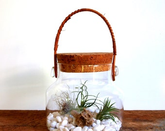 Unique vintage glass container with cork lid and woven swing handle