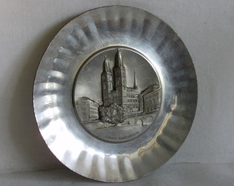 Zurich Grossmunster. Vintage metal wall hanging plate. Romanesque protestant church, Switzerland, European. Embossed, Swiss, silver tone.