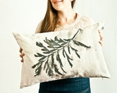 Pillow cover with black leaf
