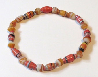 Orange paper bead Bracelet upcycled from magazine paper.