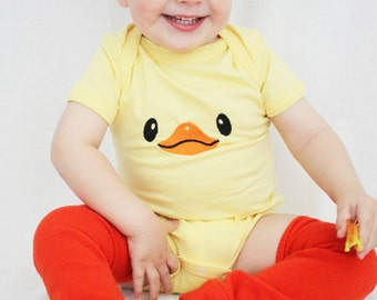 Duck Face Easter Baby Outfit Yellow bodysuit with duck face and orange baby leg warmers