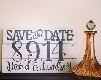 hand-painted save the date wooden sign