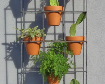 vertical garden a steel plant stand for both indoor and. Black Bedroom Furniture Sets. Home Design Ideas
