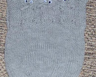 Grey vest with elephant features both on the front and the back.
