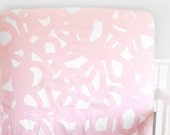 Woolf With Me® Fitted Crib Sheet in White and Pink Swirl