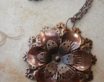 Copper floral ornate pendent on copper chain