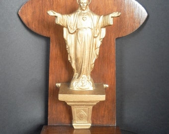 Vintage metal statue Jesus Christ Sacred Heart with Aureole and with original wooden shrine 1920s Belgium.