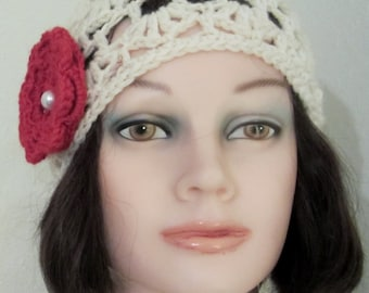 Cloche- Woman's stylish crochet hat in ivory wool, embellished with contrasting red flower. Imitation pearl button at its center.  Trendy!