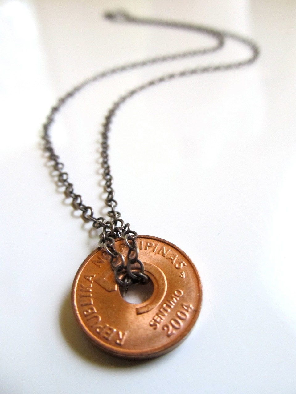 luck charm necklace with philippine coin on antique