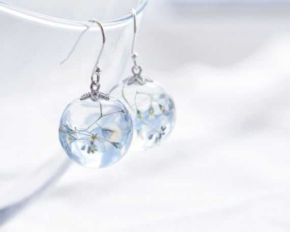 forget me not earrings pale blue flowers in clear by