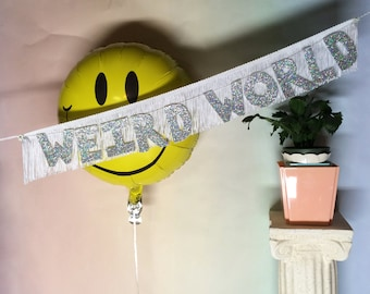 Weird World Glittering Fringe Banner | fringe wall hanging, party banner, home decor, dorm decor, funny banner, letter garland, weird times