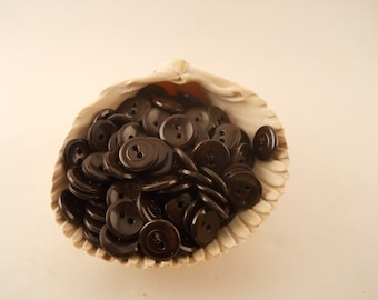 BUTTONS:  Brown concave buttons, 1 gross (144), just over 1/2 inch