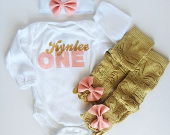 Personalized First Birthday Peach and Gold Sparkle ONE One Piece and Sparkly Bow Leg Warmers and Headband