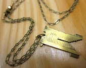 Vintage brass linotype necklace. Font nerd alert!