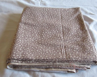 Four yards of 44 inch wide brown floral fabric suitable for quilting.