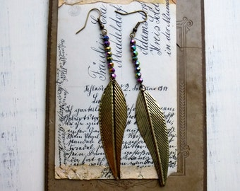 Free Spirit Dangle Earrings with Faceted Iridescent Glass Beads and Long Leaf Stampings. Boho Chic Jewelry
