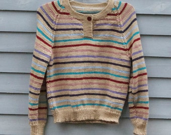 Girl, size 12/14, one button, multi striped sweater.
