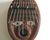 zen sanza. A really cool sounding classic kalimba with face carving