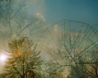 lost park: surreal photography. winter photography. ferris wheel. abandoned place. fine art print.  multiple exposure photo. icy blue sky.