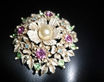 Floreniza vintage brooch 40s to 50s. gold antiqued enameled pearl center with pink green stones signed